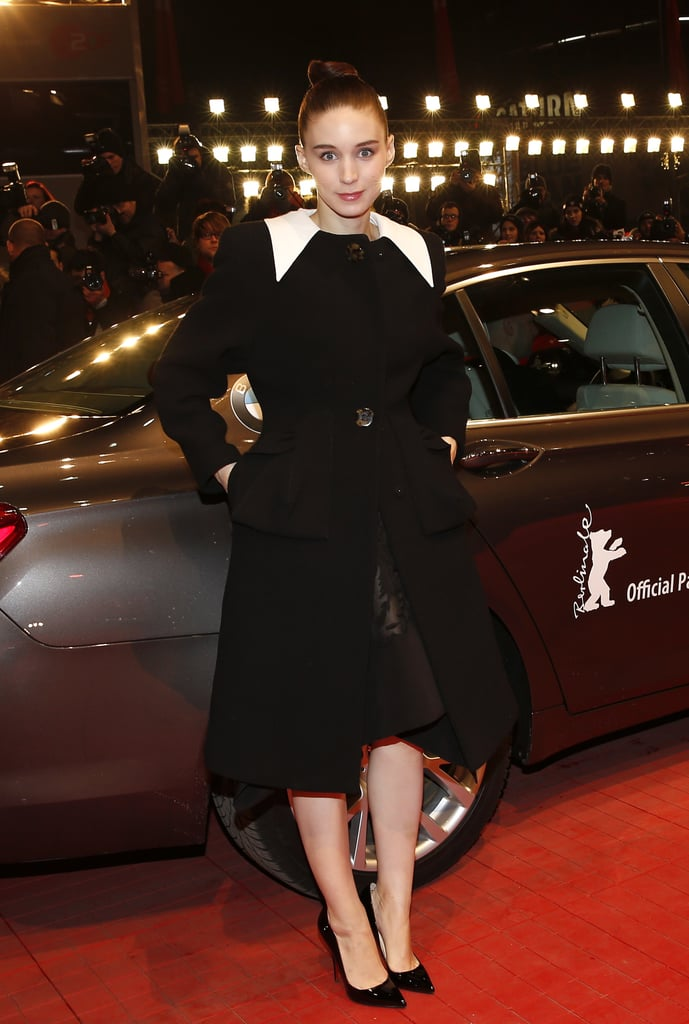Upon her arrival to the Berlin premiere, Rooney covered up in a sleek black and white coat.