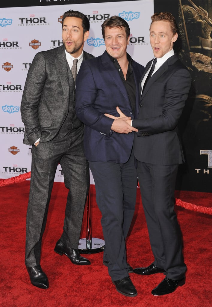 Tom tickled Nathan Fillion while Zachary Levi looked on.