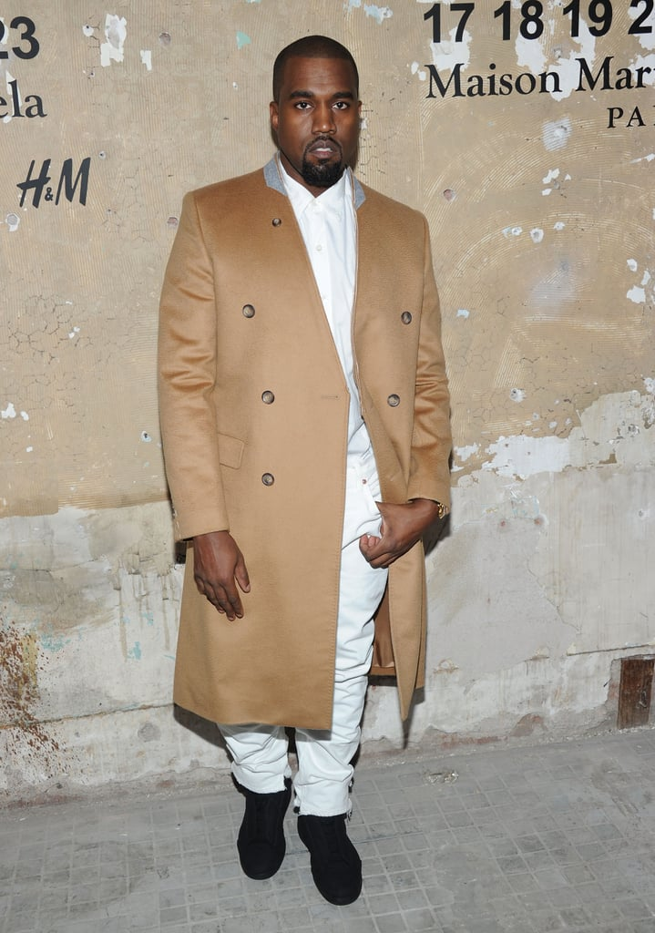 Even Kanye joined the festivities — and surprised the crowd with a departure from his usual all-black look, opting for a classic camel coat worn over a white button-down and white jeans.