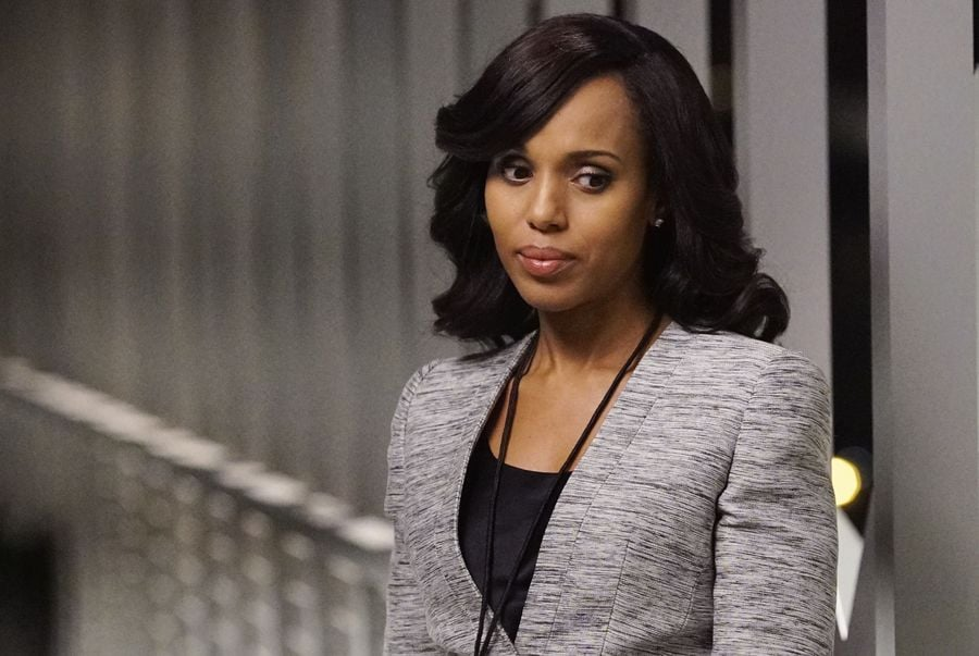 Looking more like her old self, Olivia added charcoal blazer to a black top.