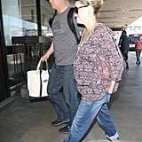 Reese Witherspoon headed into the airport to catch a flight out of LA.