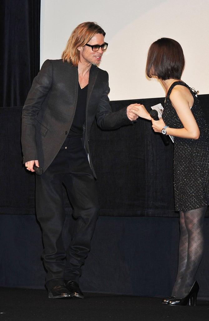 Brad Pitt thanked a woman on stage for her warm introduction.