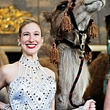 A Rockette poses with a camel.