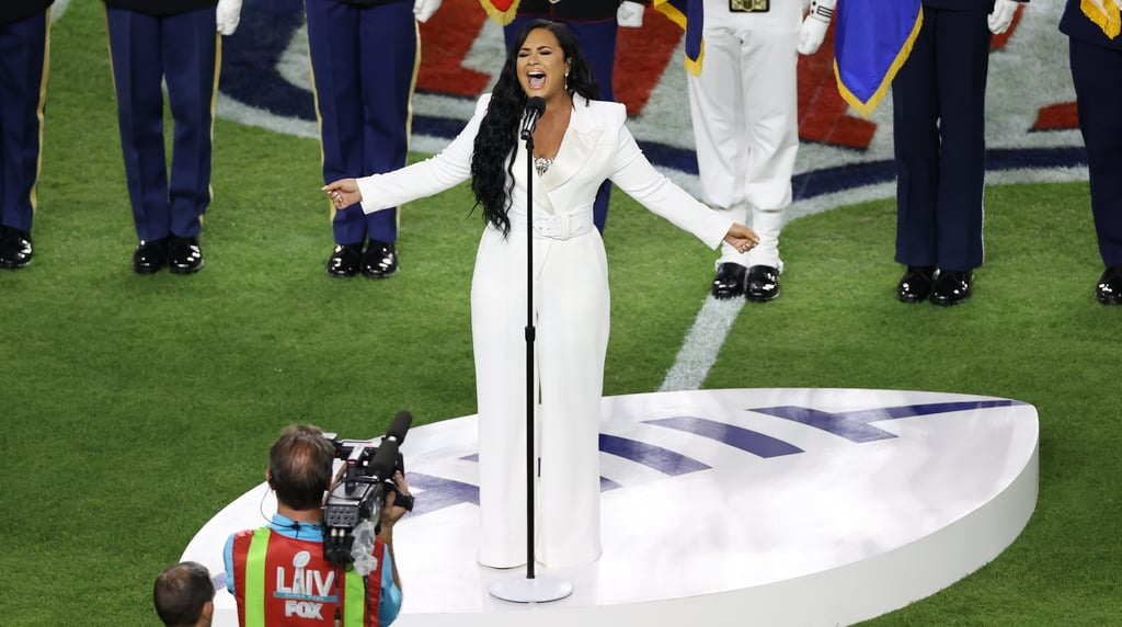 Demi Lovato's White Sergio Hudson Jumpsuit at the Super Bowl