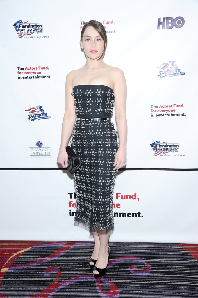 Games of Thrones actress Emilia Clarke was exquisite in her embroidered black silk bustier dress by Christian Dior at The Actors Fund 2013 Gala in NYC. Black patent peep-toes and a matching silk clutch added further polish.
