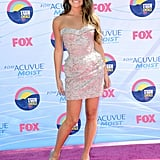 Lea Michele sparkled on the red carpet at the Teen Choice Awards in August, clad in a strapless silver minidress by Versace Couture.