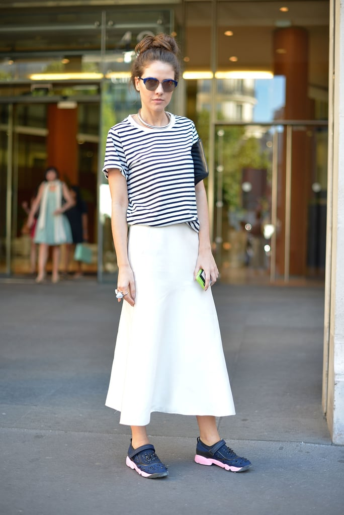 A maxi skirt adds a sophisticated feel to a casual tee and sneakers.