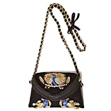 This bag has got character. It's a little funky, with a classic chain-strap finish.  Zara Embroidered Velvet Box Handbag ($80)