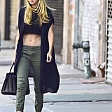 Wearing a crop top and trousers.