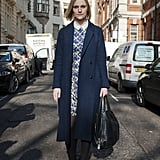 A charming London look with a printed sheath and sweet collar peeking out from underneath a smart wool coat.