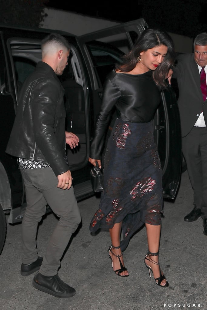 "Nothing screams ""we're a hot, new celebrity couple"" like matching outfits! Priyanka Chopra and Nick Jonas confirmed their rumoured romance on Thursday night while stepping out for dinner in West Hollywood. If Nick opening the car door for the Quantico actress wasn't sweet enough, their matching outfits absolutely were. Don't believe us? Priyanka's silky shirt bore a striking resemblance to Nick's edgy leather jacket. Throw in the prints on her shimmery midi skirt and his patterned button-down, and we've got ourselves a matching duo. Their relationship may be new, but it absolutely has ""couple goals"" written all over it. Read on to see photos of Priyanka's chic date-night outfit, and shop similar skirts ahead.      Related:                                                                                                           25 Fashion Tips From Priyanka Chopra Based on Her Most Iconic Outfits"