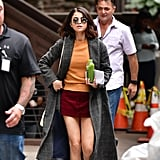 Selena Gomez's Orange Sweater and Red Skirt