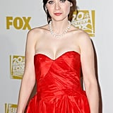 Zooey Deschanel wore red to the Golden Globes after party.