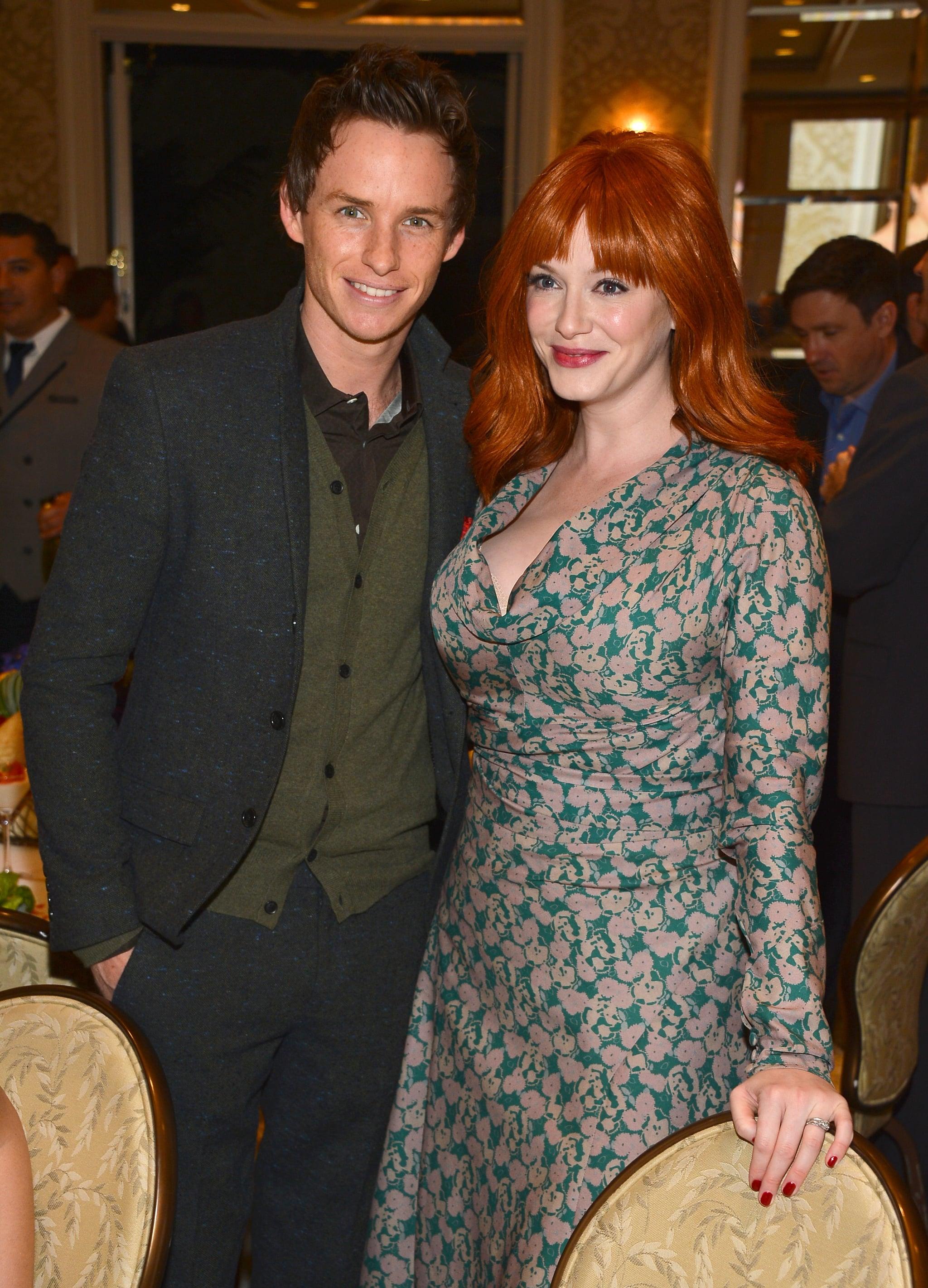 Christina Hendricks took a photo with Eddie Redmayne at the AFI Awards.
