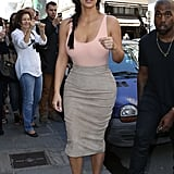 While sightseeing with Kanye at her side, Kim perfected the sexy-sophisticate vibe in a scoop-neck bodysuit and hip-hugging pencil skirt.