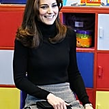 Kate's outfit consisted of a black turtleneck, checked skirt by Le Kilt, and a Mulberry clutch.
