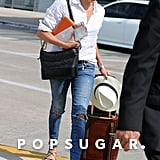 Meghan carried her Stow case at the Austin airport in June 2017. She coordinated it with her Ghurka luggage and J.Crew basics, including an eye-catching pair of strappy sandals.