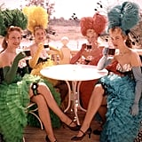 A group of showgirls sat outside the Golden Horseshoe saloon and enjoyed a cold drink to celebrate the opening.