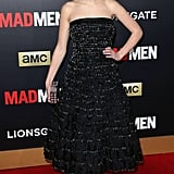Kiernan Shipka's black strapless A-line silhouette was perfectly playful. When it came to her accessories, she stuck to the same vibe, slipping into embellished silver heels and carrying a matching box clutch.