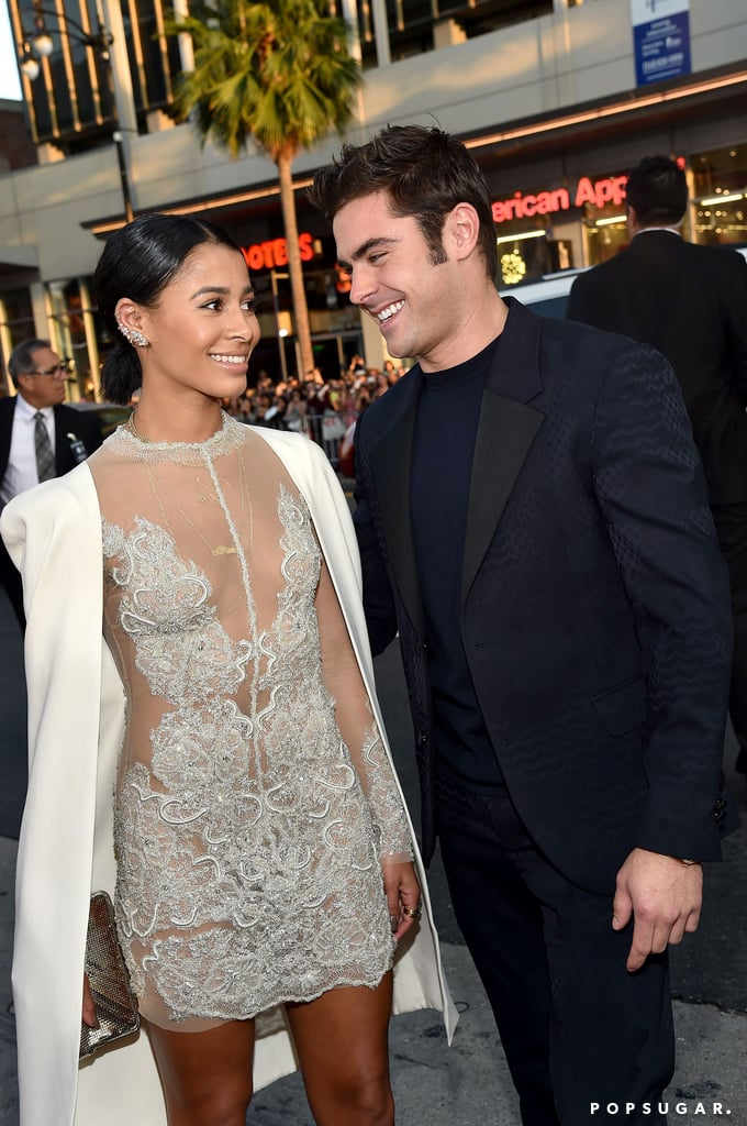 """Zac Efron had the support of his girlfriend, Sami Miró, during his big night on Thursday. The couple stepped out for the LA premiere of We Are Your Friends, and they shared a sweet moment while they posed for pictures, marking the first time they've been photographed together at a public event. Sami wore a OGLIA-LORO gown, and on Friday morning, she posted a photo from the event, saying, """"@wayfmovie is a force to be reckoned with."""" Keep reading for cute pictures of Zac and Sami, then check out their sweetest social media snaps and the hot kissing photo Sami shared earlier this Summer."""