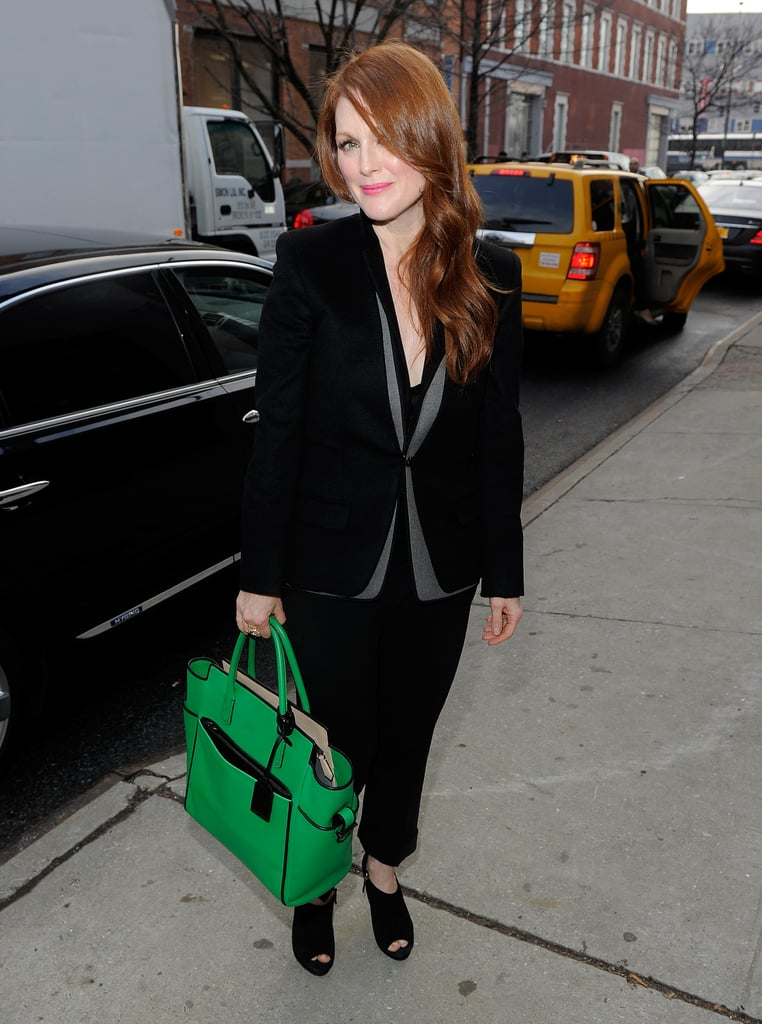 Julianne Moore, spotted at New York Fashion Week carrying a bright green tote with her all-black ensemble.