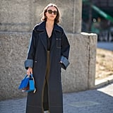 A denim coat is a fail-safe layer over olive pants. To make the combo pop, finish with a cobalt-blue accessory.