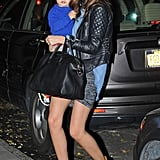 Miranda was edgy for evening in her Balenciaga quilted leather jacket layered over a flowing blue top, a T by Alexander Wang skirt, Isabel Marant boots, and her Givenchy tote.