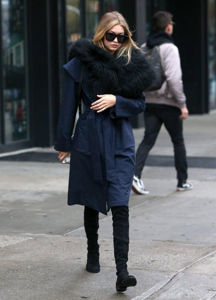 9555ccaec172 She accessorized her comfy coat with Karen Walker s Deep Worship sunglasses