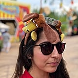 Sport a Slinky Dog or Pizza Planet Alien headband.