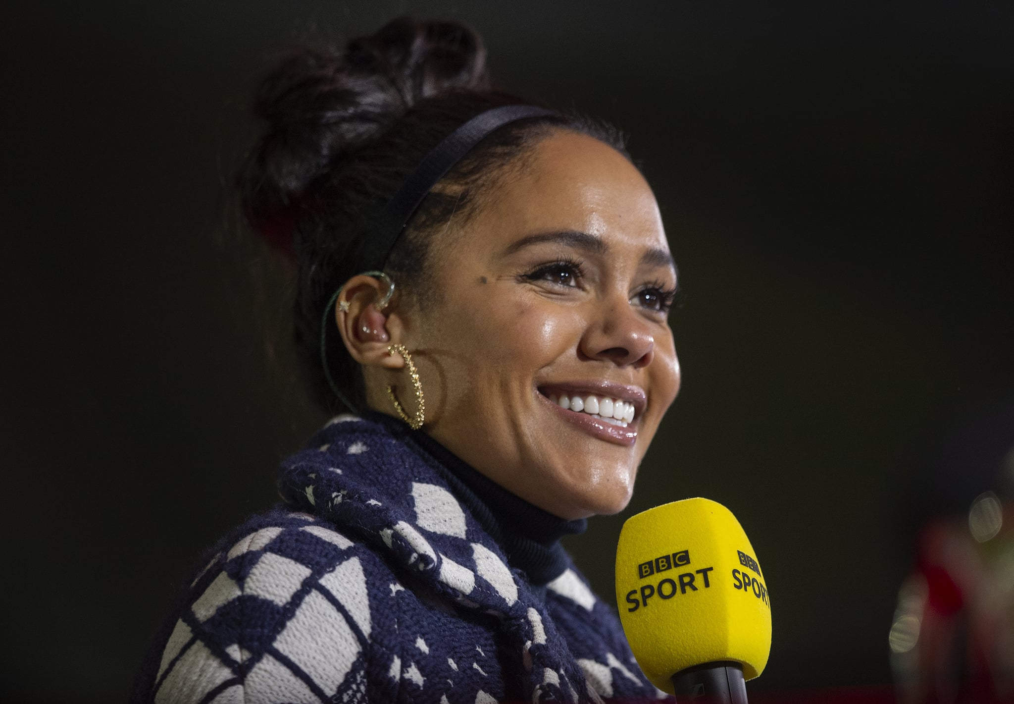 MOSTON, ENGLAND - NOVEMBER 07: BBC Presenter Alex Scott talks live on the BBC before the Emirates FA Cup match between F.C. United of Manchester and Doncaster Rovers at Broadhurst Park on November 7, 2020 in Moston, England. Sporting stadiums around the UK remain under strict restrictions due to the Coronavirus Pandemic as Government social distancing laws prohibit fans inside venues resulting in games being played behind closed doors. (Photo by Joe Prior/Visionhaus)