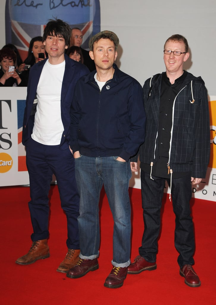 Damon Albarn, Alex James, and Dave Rowntree of Blur were casual on the  carpet
