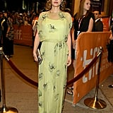 At the premiere of her movie Jackie, Natalie concealed her baby bump in an embellished green Prada gown.