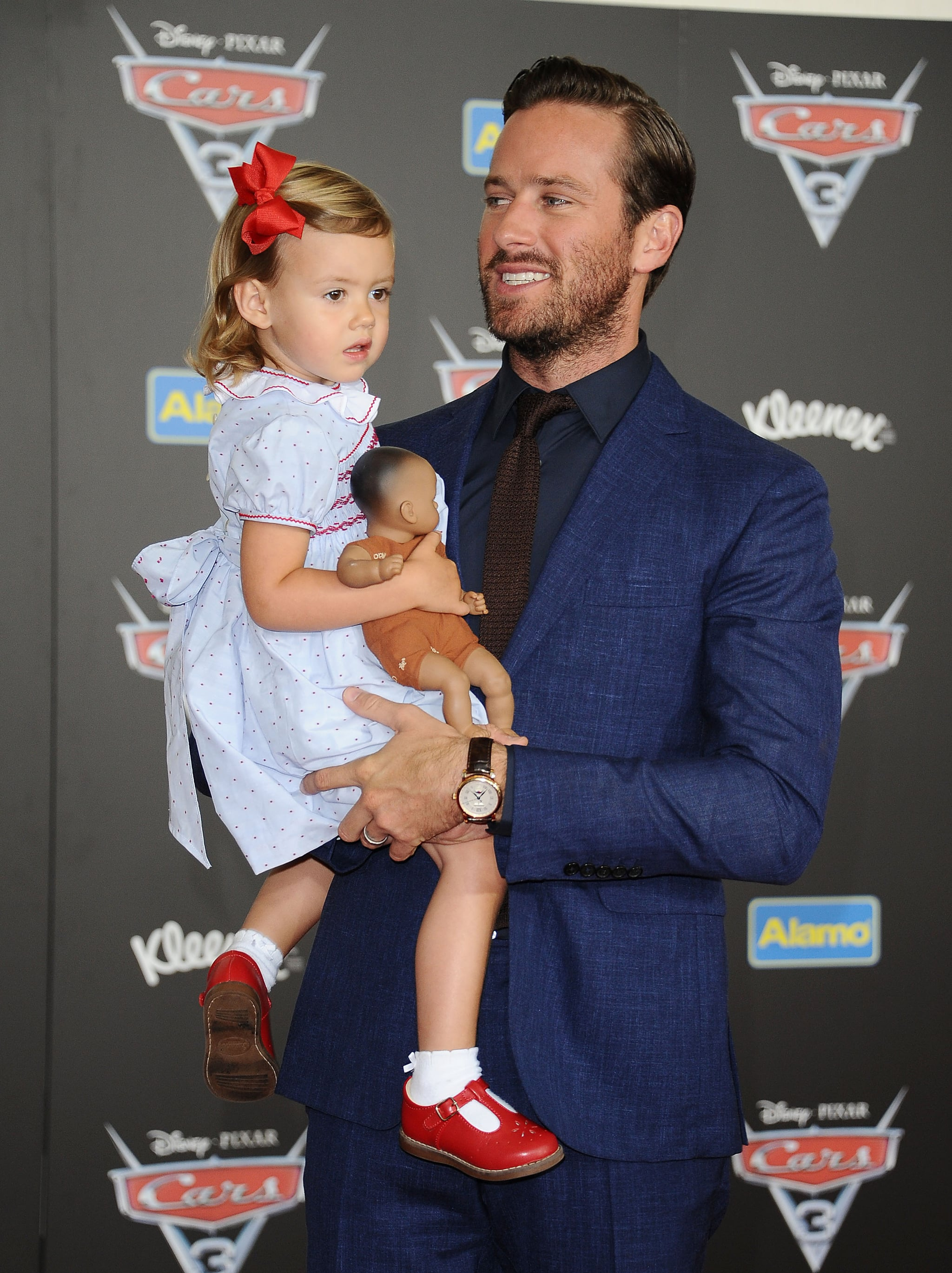 ANAHEIM, CA - JUNE 10:  Actor Armie Hammer and daughter Harper Hammer attend the premiere of