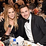 Amy Schumer and Ben Hanisch stuck close at their table.