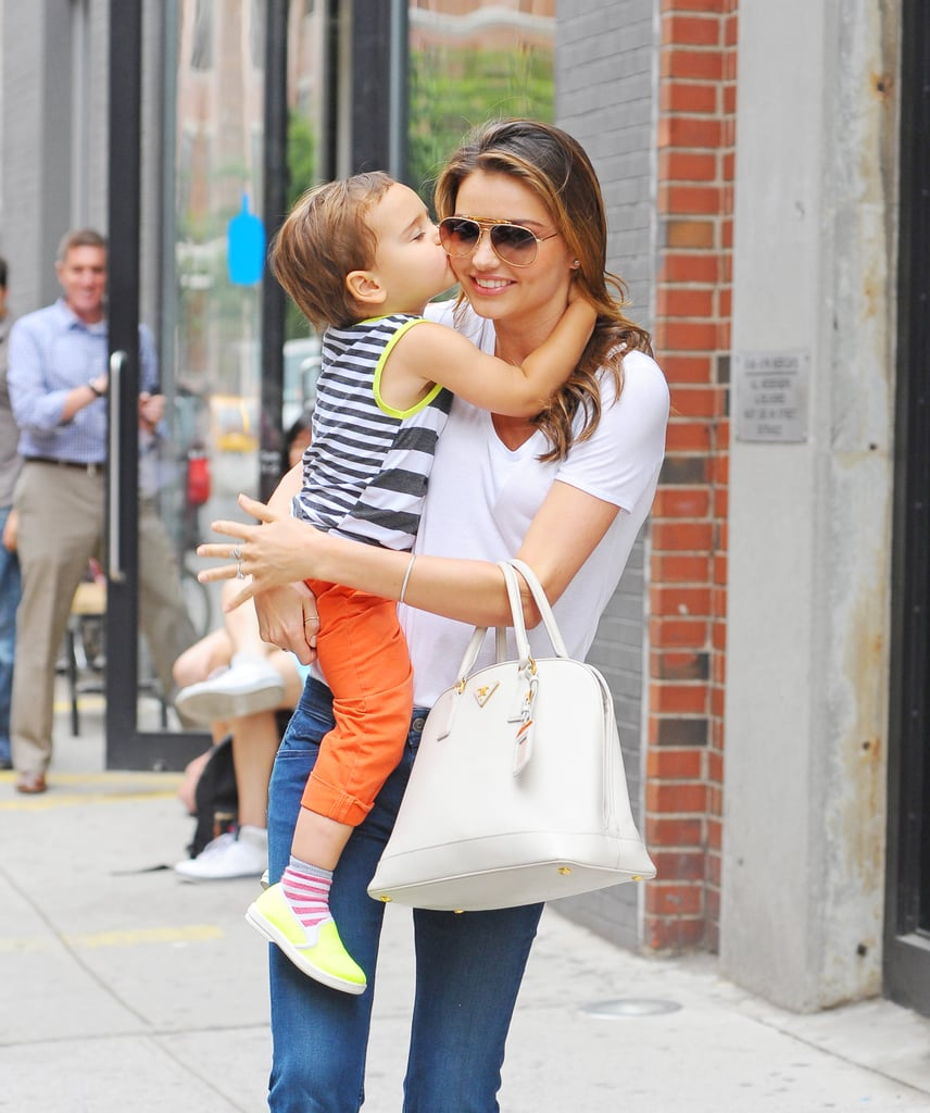 Miranda Kerr got a special treat from her son, Flynn Bloom, when the two stepped out in NYC yesterday. The tiny tot planted a big kiss on his mamma's cheek while she held onto him during their day out. The show of love is nothing new for the Kerr-Bloom family, as both Miranda and Orlando Bloom are often seen showering their little man with love. Last week, Miranda gave Flynn a tickle while the two ran errands together in the Big Apple with Miranda's dog, Frankie. When she isn't busy with her son, Miranda has been hard at work in the city. She recently hosted a press day for her skin care line, Kora Organics, and has been running from photo shoot to photo shoot for her various magazine and campaign jobs. The family's busy schedule is about to get even more full as Orlando's new play, a revival of Romeo and Juliet, is going into previews on Broadway this month.