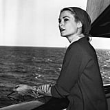 """Grace turned her trip to Monaco into a symbolic gesture. Instead of flying to the principality, Grace and an entourage of 70 (including her six bridesmaids and 80 suitcases) set sail on April 4, 1956, on the S.S. Constitution out of New York harbor. By physically crossing the ocean, her trip served as a symbol of linking the US and Europe. """"The whole Constitution trip was something Mom referred to at times,"""" her son, Prince Albert III, told People. """"She'd say it was fun for the wedding party. It really bonded the whole Philadelphia side, her family and friends who came over together on the crossing . . . she would talk about her dog, Oliver, being on board with her.""""  The Cannes Film Festival rearranged its schedule to accommodate the wedding. When Grace got off the S.S. Constitution in Monaco on April 12, she was greeted by the mayor of Cannes, who ensured the legendary film festival (where she met her husband-to-be) would not conflict with the affair.  Grace's arrival brought out the whole city. As she made her way into Monaco on Prince Rainier's yacht from the larger boat (which wouldn't fit in Monaco's small harbor), a band played """"The Star Spangled Banner"""" and press helicopters eager for a shot swirled above. A crowd of over 20,000 people watched as she carried her black French poodle in her arms and wore """"an immense white hat,"""" which many photographers later complained ruined their shots of her first stepping foot onto Monacan soil.  The first night she was there turned into a full-fledged celebration. To commemorate Grace's arrival, a dance company performed a gorgeous ballet for her and Prince Rainier and an elaborate fireworks display was set off in the couple's honor."""