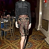 Karlie Kloss opted for a dark skirt and a patterned pencil skirt.