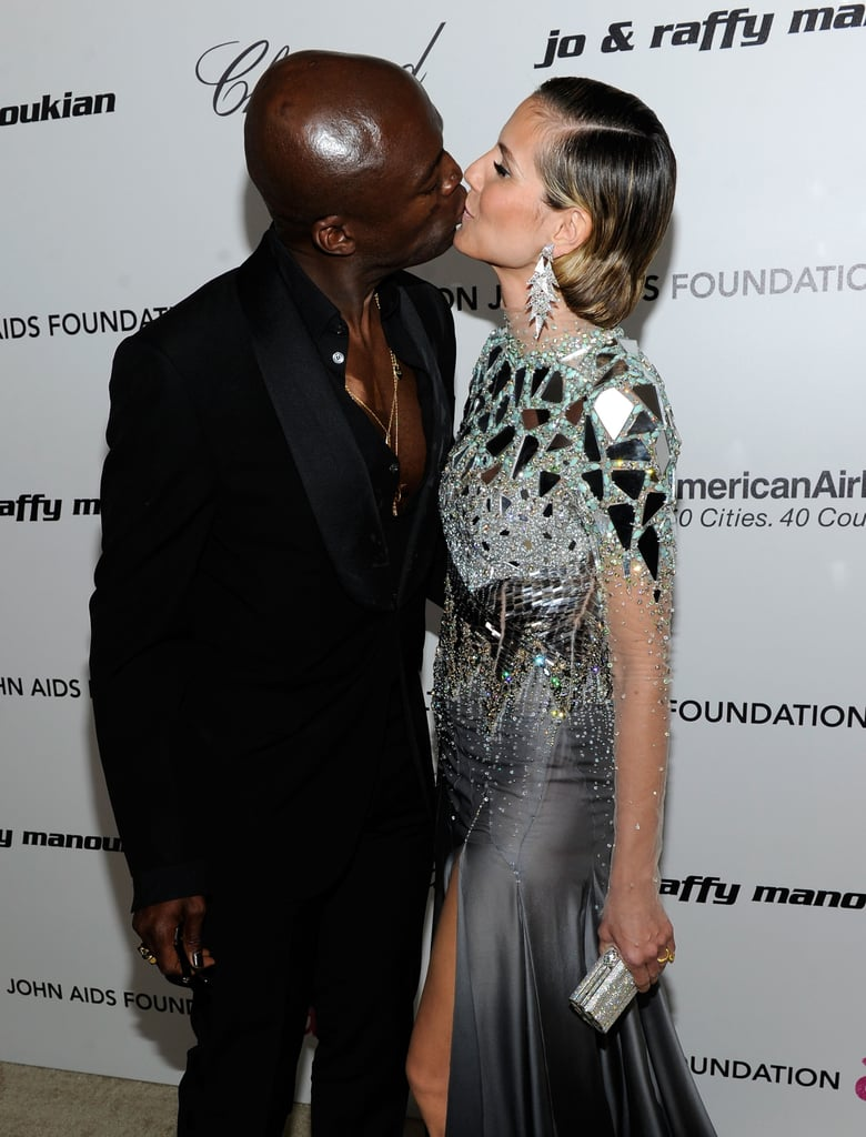 Heidi Klum and Seal put on a show of affection prior to Elton John's annual Oscar viewing party in LA in February 2011.