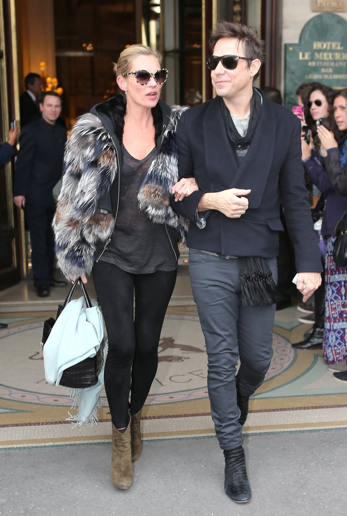 Kate Moss and Jamie Hince kept close as they left the Meurice Hotel in Paris together yesterday. The pair were greeted by waiting fans as they headed off after wrapping up Fall Fashion Week in France.  Kate made a surprise appearance at Louis Vuitton just hours before she and Jamie departed. Wearing a short, black wig and a sheer gown, Kate walked for longtime friend Marc Jacobs in the show. Kate also stepped out for former French Vogue Editor Carine Roitfeld's launch party for the second issue of her CR Fashion Book during her time in the City of Light, mingling with other notable names, including Jessica Chastain.