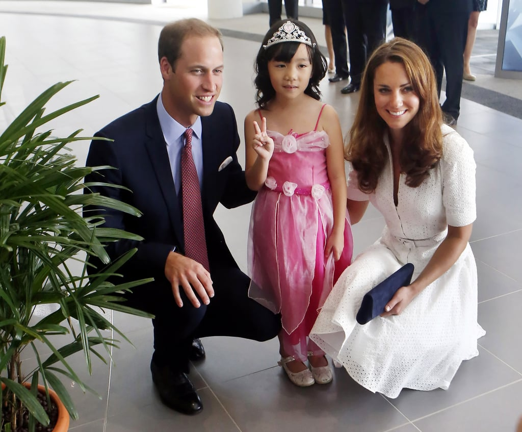 Prince William and Kate posed with a 4-year-old dressed as a princess as they toured a Rolls-Royce factory in Singapore in 2012.