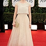 Zooey Deschanel wore a cream-colored look and red lipstick.