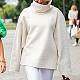 Go all-white for Winter by way of a pair of longer-line shorts and an oversize turtleneck on top.