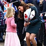 Kate Receiving Flowers From Children 2012