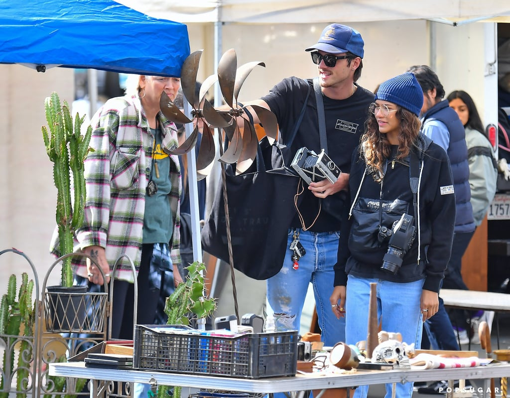 """Zendaya and Jacob Elordi are clearly well aware that Sundays are for lovers, because over the weekend, the couple stopped by an LA flea market to do a little shopping. The Euphoria costars were as cute as can be as they scoped out some vintage treasures and hung out with Zendaya's mom, Claire Stoermer. And things only got cuter when Jacob tried on a mask and posed for a silly photo for Zendaya. Don't these two always look like they're having the best time together?  Even though Zendaya and Jacob didn't show PDA this time around, they have been quietly dating since late 2019. """"They started as close friends, but it became romantic after their show ended,"""" a source told E! News. """"Jacob has met Zendaya's family and everyone adores him. They have a lot of fun together and have a lot in common."""" See more of Zendaya and Jacob's fun date ahead.       Related:                                                                                                           A Full Rundown of Zendaya and Jacob Elordi's Short-Lived Romance"""
