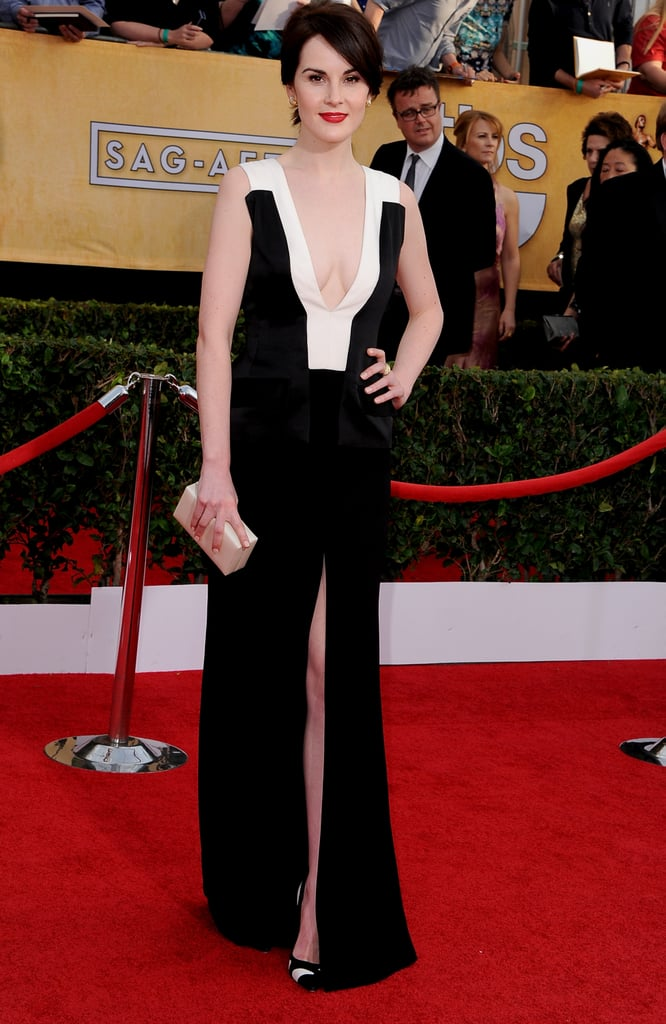 Michelle Dockery pumped up the sex appeal when she arrived at the 2014 SAG Awards in LA on Saturday night while wearing a low-cut black and white J. Mendel gown and matching Gianvito Rossi heels. The actress and her cast are nominated for the award for outstanding performance by an ensemble in a drama series for their work on Downton Abbey. She has had a busy award season so far, topping many fashion best-dressed lists at last weekend's Golden Globes in a more Lady Mary-appropriate light blue frock. Keep reading to see Michelle at this year's SAG Awards! Be sure to vote on all the looks from tonight's show in our red carpet fashion and beauty polls!