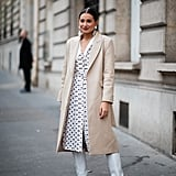A tailored jacket and white boots feel fresh with a polka-dot dress for Spring.