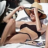Allison Williams lounged in a brown bikini with a straw hat during a trip to Miami.
