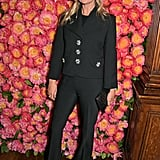 Moss softened her usual signature black suit with sparkling floral buttons for the opening of Michael Kors new flagship store on Bond Street.