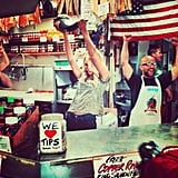 "Candice Swanepoel shared a photo while ""catching fish like a pro"" at the Pike Place Fish Market in Seattle. Source: Instagram user angelcandices"