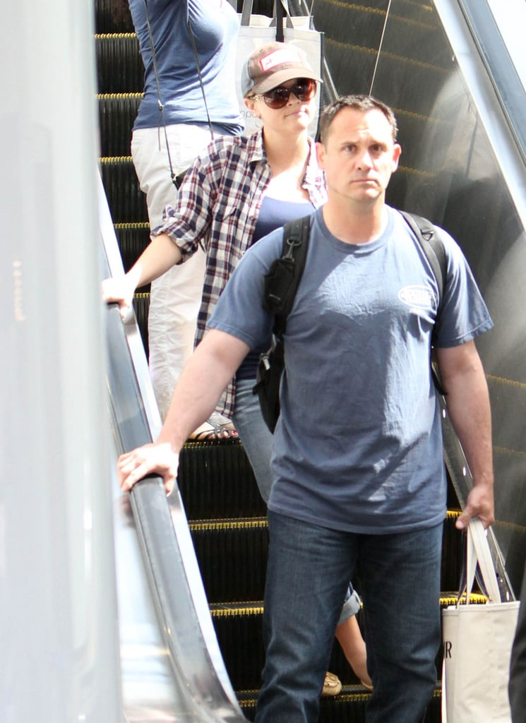 Reese Witherspoon held onto an escalator at LAX Airport.